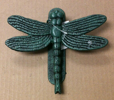 "Cast iron antique teal color dragon fly door knocker. Measures 7"" x 7"""