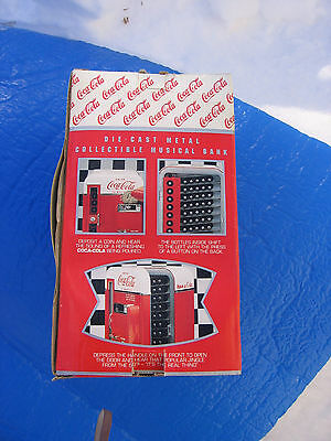 VINTAGE BOX ONLY. Coca Cola Die Cast Metal Musical Bank Vending Machine #128910