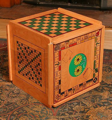 Chess,  Backgammon, Cribbage, Chinese Checkers and more on a wooden table. Cool.