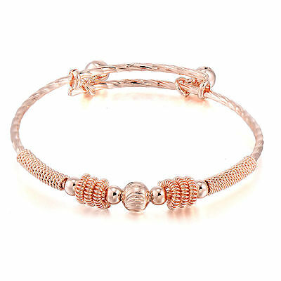 GORGEOUS BABY GIRLS 18k ROSE GOLD  ADJUSTABLE BANGLE.WITH JINGLE  BALLS