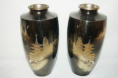 Pair of Japanese Enamel Vases with Pagodas and Signatures.