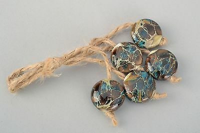 Flat Glass Beads Made Using Lampwork Technique