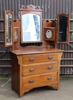 A Victorian Carved Walnut Mirrored Dressing Table over Chest Base