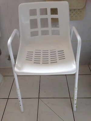 Shower chair. Adjustable height. Perfect condition