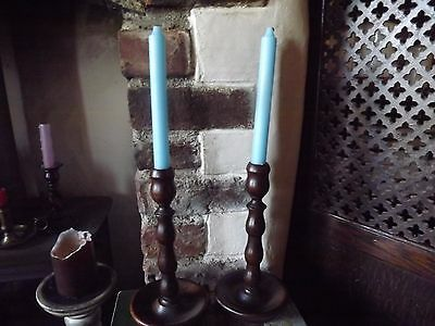 A Pair Of Vintage Wooden Candle Sticks