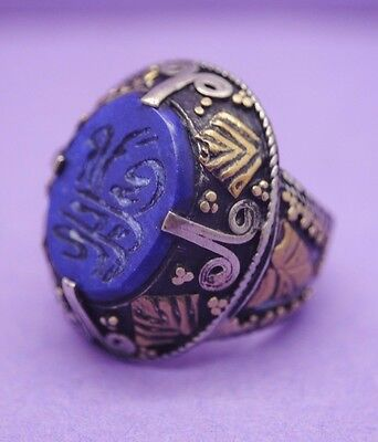 Post Medieval Islamic silver ring inlaid with gold and calligraphy seal insert