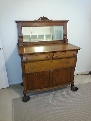 antique oak, claw foot, 3 drawer, bow front cupboard dresser with beveled mirror