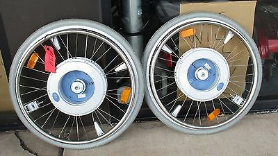 pair of used E-Motion M12 power assist wheels with no batteries or remote gd nr