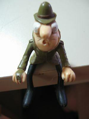 Inspector Clouseau sitting figure Pink Panther character