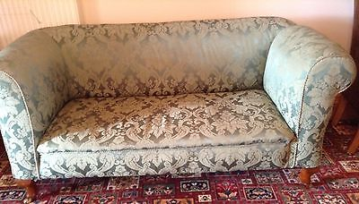 Antique drop end sofa in a soft green shade