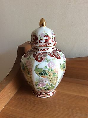 Oriental small lidded vase decorated with peacocks very good condition