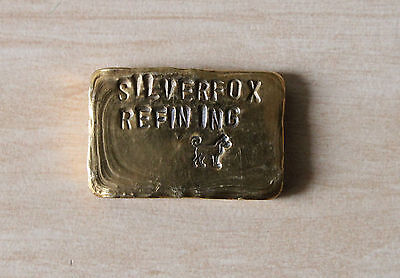 1.77 troy ounce ingot of .999 pure gold by Silverfox Refining.