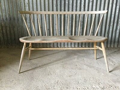 Ercol love seat in found condition.