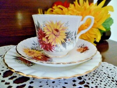 ROYAL STAFFORD Cup, Saucer and plate set MAROON AND GOLD DAISIES