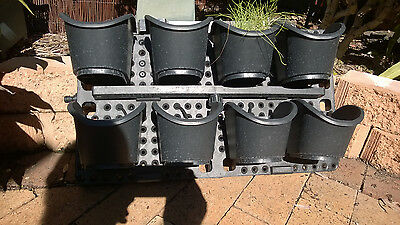 Pots for herbs with watering system