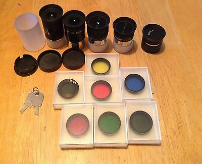 Lot of 12 different telescope lens, eyepieces, and dustcover caps