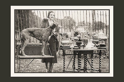 PHOTO TAKEN FROM A 1930's IMAGE OF MICK THE MILLER WITH OWNER AND TROPHIES