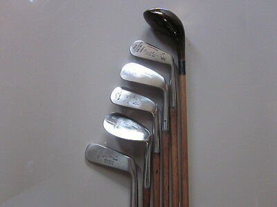 A set of hickory golf clubs, fully restored Brassie, 4 irons and a putter