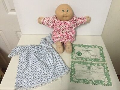 Baby Cabbage Patch doll, vintage, not all original clothes, with birth cert.