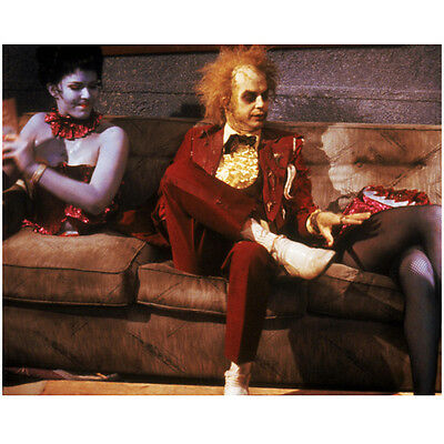 Beetlejuice Michael Keaton sitting on couch touching legs 8 x 10 Inch Photo