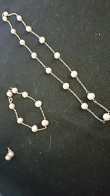 beautiful set of yellow 14k gold pearl necklace bracelet and earrings