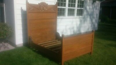 Century-old antique oak carved headboard 6' tall, footboard 3' tall, & bedframe