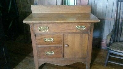 antique oak wash stand in good condition $200.00