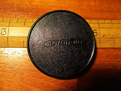 Vintage Voigtlander 47mm lens cap. One springy part about to break off, two OK.