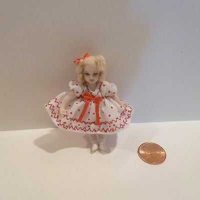 Adorable Miniature Little Girl Doll With Blonde Ringlets In Her Hair