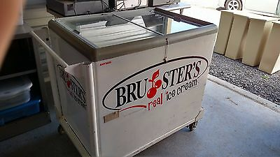Ice Cream Cart Bruster's Real Ice Cream is the logo on cart.