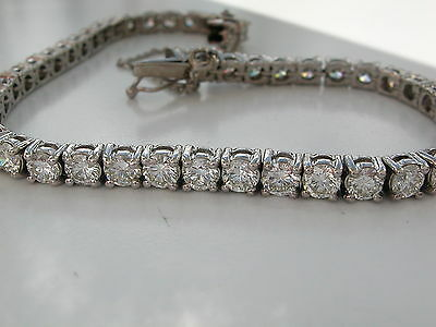 STUNNING 7.20ct DIAMOND TENNIS BRACELET. VS/SI HIGH GRADE. 18ct GOLD. REPORT