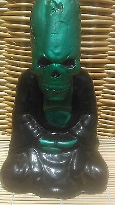Ancient alien elongated skull statue