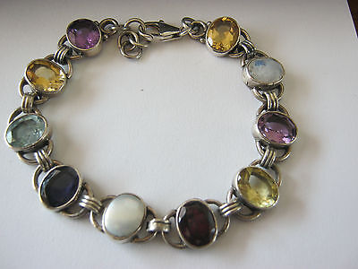 Vintage .925 stamped sterling silver link bracelet with multicolored stones