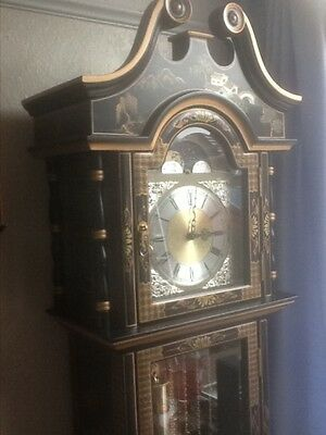 Chinese black laquered longcase clock. • £395.00