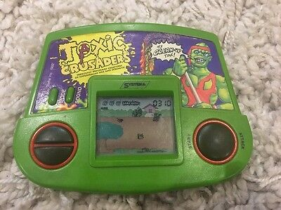 Vintage 1990s TOXIC CRUSADERS SYSTEMA ELECTRONIC TROMA GAME WATCH RETRO LCD