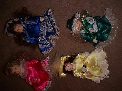 "Set of four Little posable porcelain Dolls 3"" Very Cute!"
