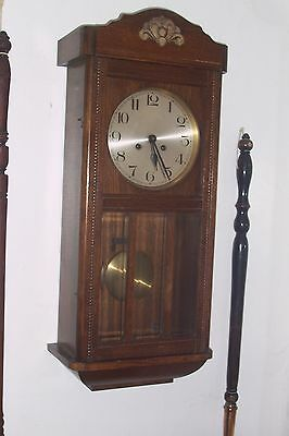 An attractive and clean edwardian wall clock,
