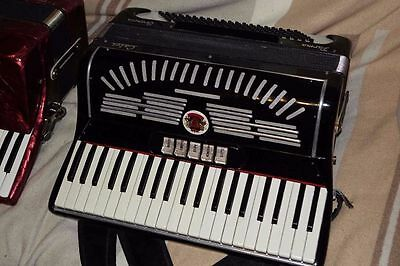 Calvi Parma 4 voice musette tuned accordion.41 key 120 bass. Cased.
