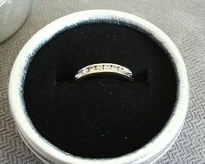 White gold ring w 6 channel set diamonds (approx. size M)