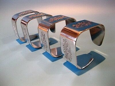 Elegant Vintage Very Distinctive Set of 4 Silver Plated Pendragon Napkin Rings
