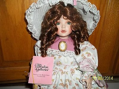 Paradise Galleries - Porcelain Doll  - she plays music