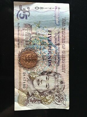 Guernsey: £5 banknote in Fine condition. Serial number: C880315