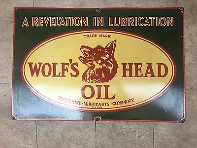 Vintage Wolf's head Oil Porcelain Enamel Sign.
