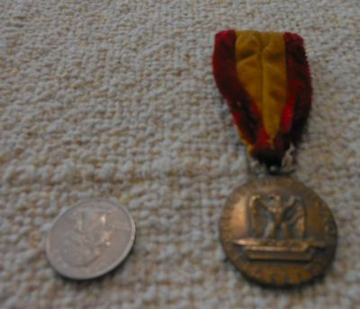 vintage WWII good condct medal and sterling silver USMC pin