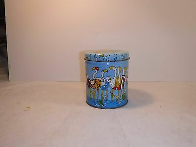 Metal canister with flamingo motif