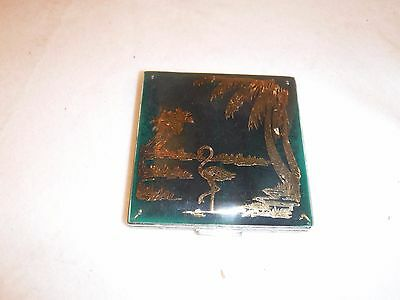 Vintage silver plated compact with flamingo motif on green Lucite