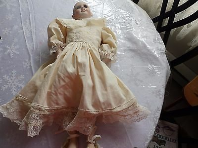 Porcelain Doll in Need of Repair 21 Inches Tall