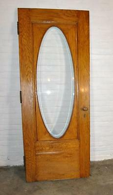 """Oak 80"""" by 31.75"""" Entry Door with Oval Beveled Glass"""