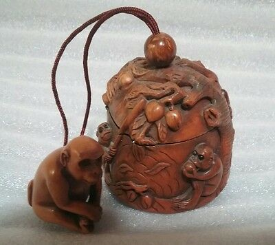 Old Signed finely carved monkey family netsuke tobacco pouch?