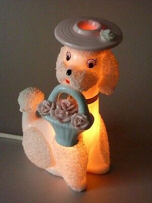 Vintage 50.s Poodle Holding Basket Of Flowers  Night Lamp. Nice Condition.